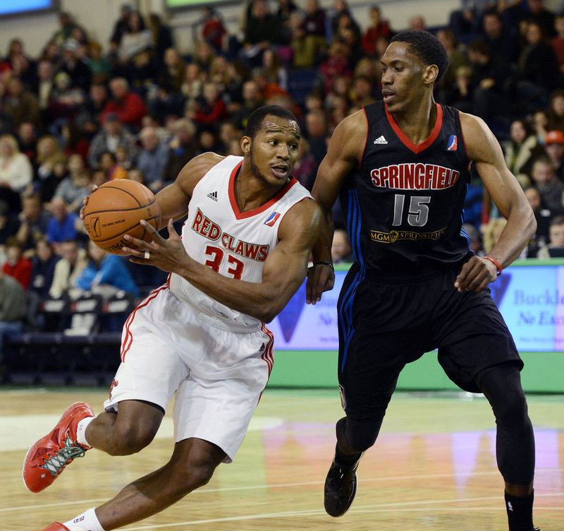 Chris Wright tries to turn the corner against Paul Carter of the Armor. Wright finished with 25 points and 16 rebounds to pace the Red Claws, who don't play again at the Expo until March 1.
