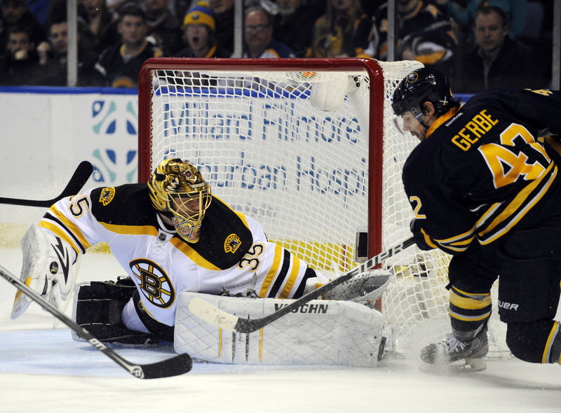 Bruins goaltender Anton Khudobin makes a save on Sabres left winger Nathan Gerbe, a former Portland Pirate, during the first period of Boston's 3-1 win at Buffalo.