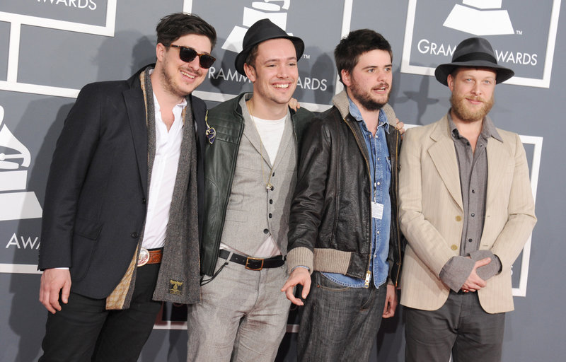 "From left, Marcus Mumford, Ben Lovett, Country Winston and Ted Dwane of Mumford & Sons arrive at the Grammy Awards on Sunday. Even the London folk-rockers themselves – stars of the 2012 Gentlemen of the Road Stopover in Portland – were surprised when their ""Babel"" won album of the year."