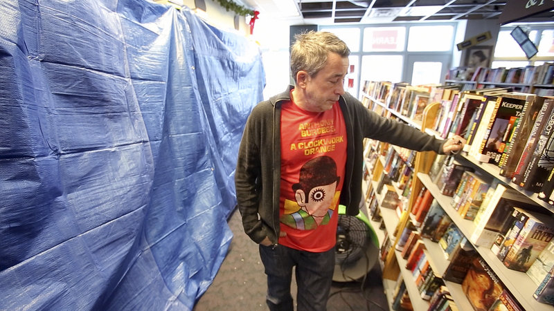 Chris Bowe, co-owner of Longfellow Books in Portland, says that each of the 30,000 books in the store will have to be looked at to see which have suffered water damage after a pipe burst in the bookstore over the weekend.