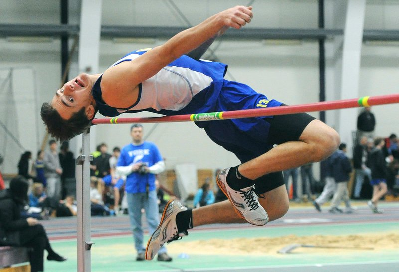 Ian Tait of Falmouth clears the bar in the high jump at 5 feet, 6 inches. Gray-New Gloucester's Elijah Locke of won the event at 6-0, and Tait placed fifth.