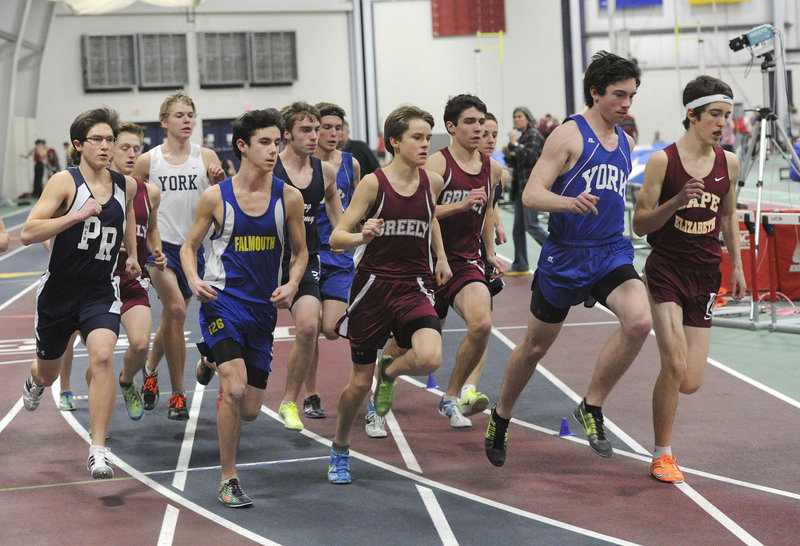 Runners negotiate a turn early in the boys' mile Monday night at the Western Maine Conference indoor track and field championships in Gorham. The York boys and Greely girls repeated as team champions.