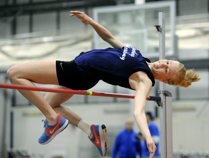 Emily Heggie of Fryeburg Academy goes over the high jump bar at 4 feet, 8 inches. Heggie went on to win the event with a height of 4-10.