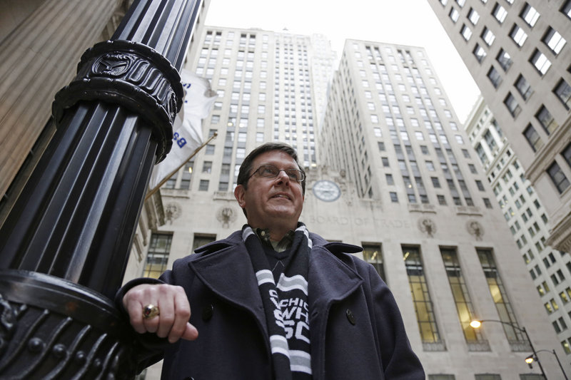 Sean Toohey, a grains broker at the Chicago Board of Trade who had hip replacement surgery last summer, walks home from work Monday. Toohey said he has health insurance so he didn't ask about the price, but with workers paying higher co-payments and deductibles, more people may start doing so.
