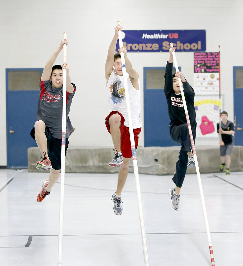 Scarborough pole vaulters, from left, Alec James, Greg Viola and Edward James hope to scale new heights Monday during the Class A championships at the University of Southern Maine in Gorham.