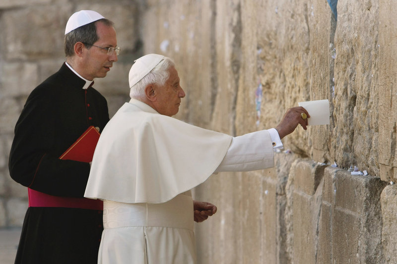 Pope Benedict XVI places a note in the Western Wall, Judaism's holiest site, in Jerusalem's Old City in 2009.