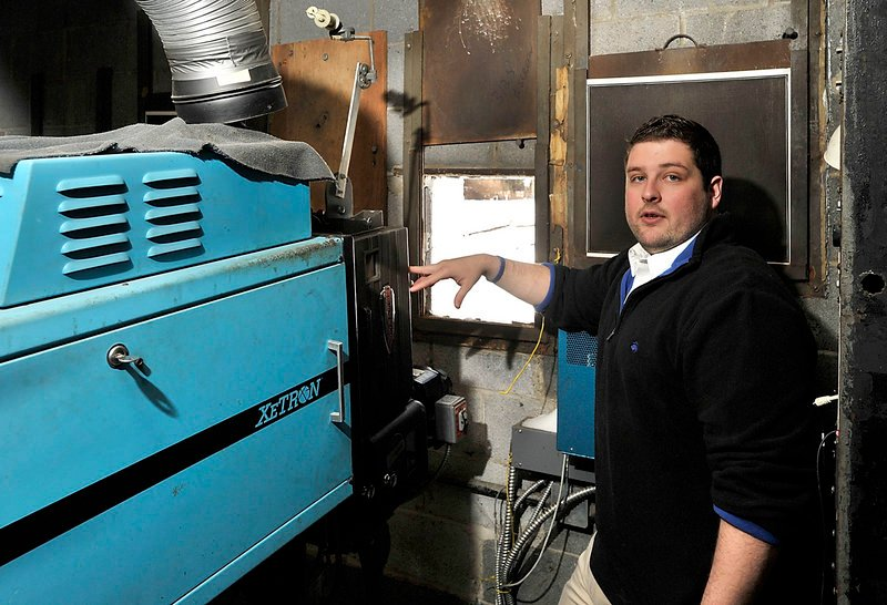 Ry Russell, who runs the Saco Drive-In, says this old film projector that has to be replaced with a digital projector at the cost of about $90,000 if the theater is to survive. Photographed on Wednesday, Feb. 13, 2013.