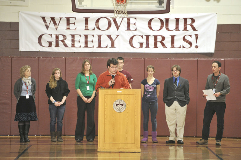 Greely High School held a school-wide assembly in their gym to address biased language and offensive speech in response to an incident last week. Max Bahlkow, a senior and president of Greely's Civil Rights Team, reads a statement to the gathered students during the assembly.
