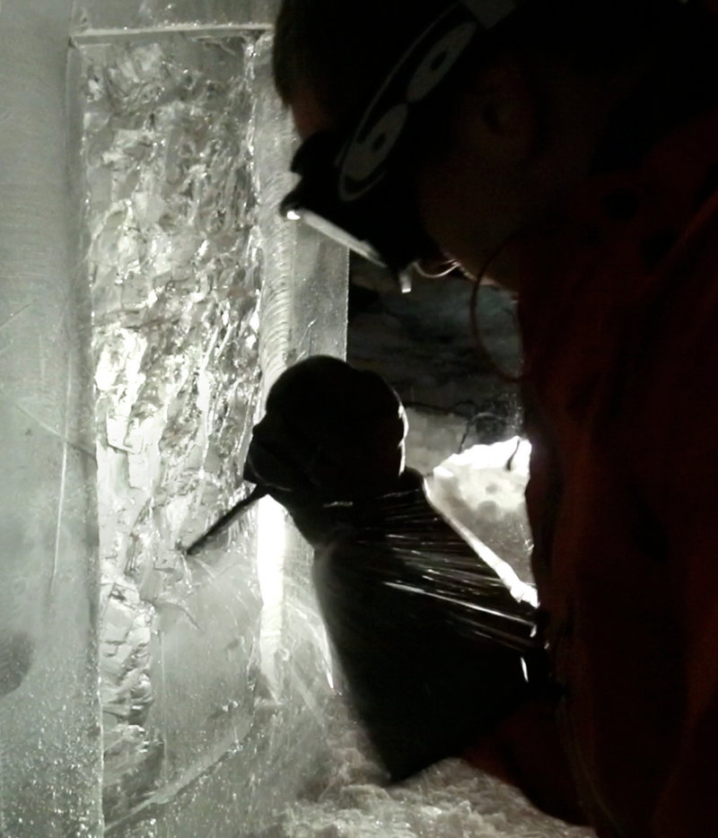 Ice sculptor Jesse Bouchard uses a chisel to chip a detail in a block of ice at his South Portland home on Tuesday, February 12, 2013. The blocks will be constructed into an ice bar at the Hilton Garden Inn in Freeport on Friday night.