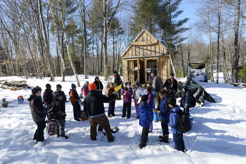"Teacher Glenn Powers lectures students by the warming hut at the Hidden Valley Nature Center in Jefferson as part of the curriculum of the ""40 Days in the Woods"" program."