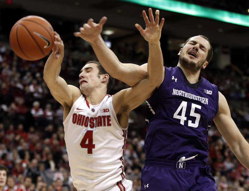 Aaron Craft of Ohio State holds off Nikola Cerina of Northwestern and chases down a rebound Thursday night during Ohio State's 69-59 victory at home.