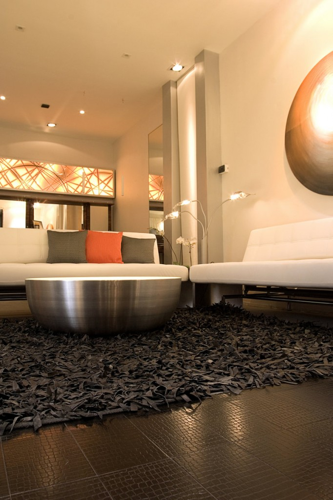 Flooring made of recycled leather boosts the modern look in this edgy living space.
