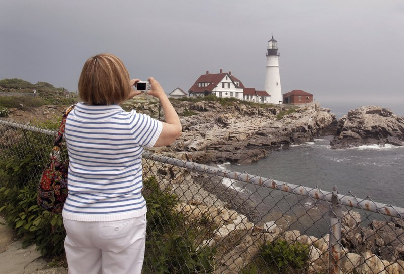 A visitor from Florida takes a picture of Portland Head Light in Cape Elizabeth. Natural beauty is part of what the state stands for, a reader says.