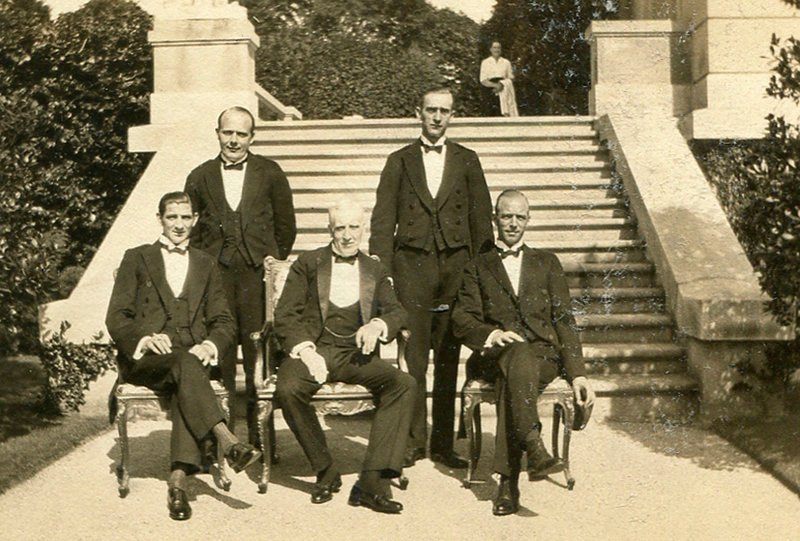 This 1920s image shows butler Ernest Birch, center, surrounded by footmen at The Elms mansion in Newport, R.I. Newly discovered photographs and documents have inspired the creation of a tour about servants at The Elms.