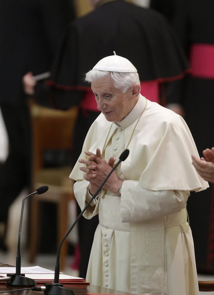 "Pope Benedict XVI prays during an audience with Roman priests Thursday in the Vatican. The papal election process grants authority to ""sexist yes-men cardinals"" at the expense of elected priests, religious and laity, a reader says."