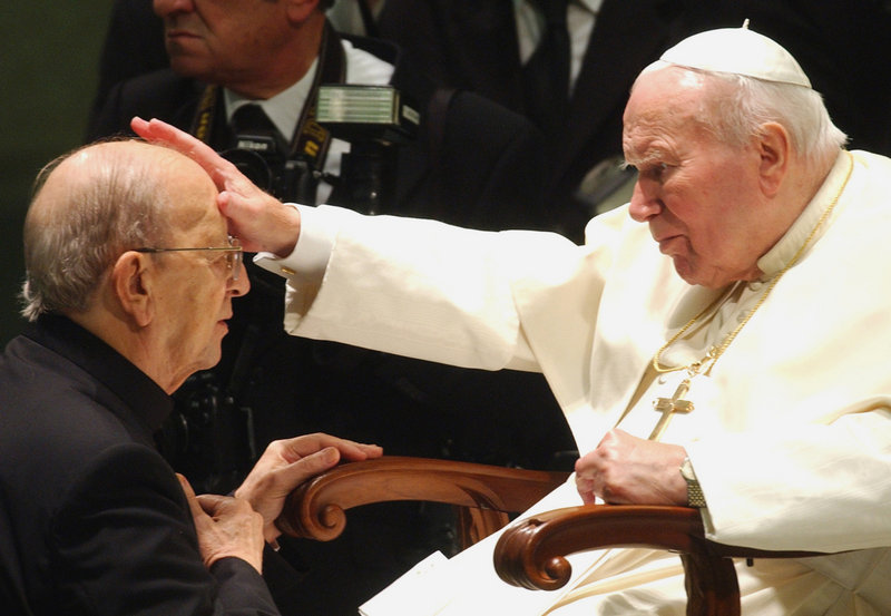 Pope John Paul II gives his blessing to the Rev. Marcial Maciel, founder of the Legion of Christ, at the Vatican in 2004. A Vatican investigation later discredited Maciel.