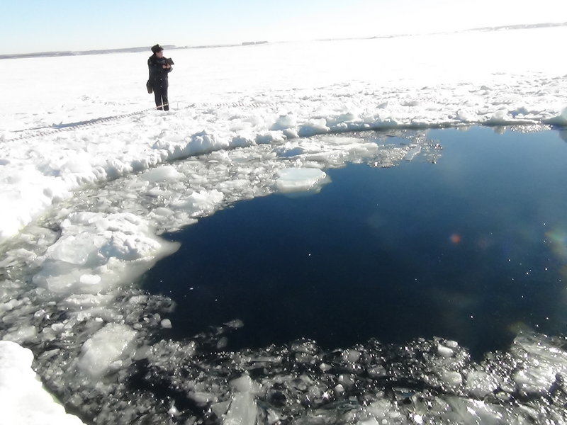 A hole in the ice of Chebarkul Lake indicates where the space rock may have struck Earth.