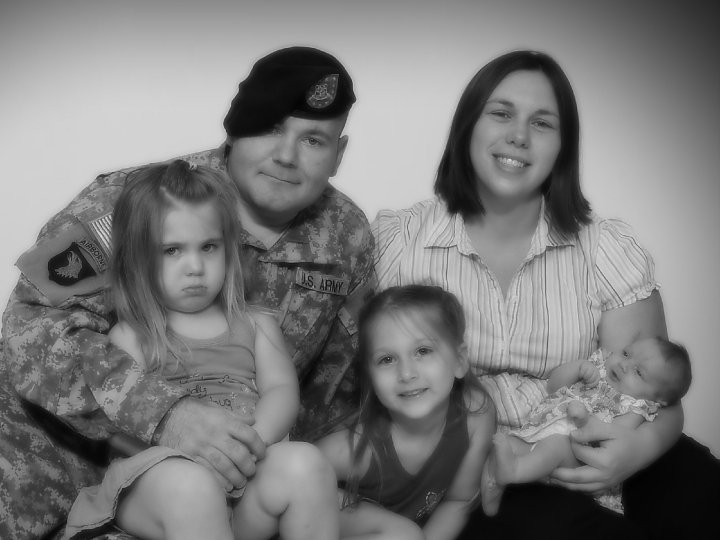 Staff Sgt. Eric Shaw poses for a family photo with his wife, Audrey, and their daughters, Victoria, Madison and Julia, just before he left for Afghanistan in June 2010.