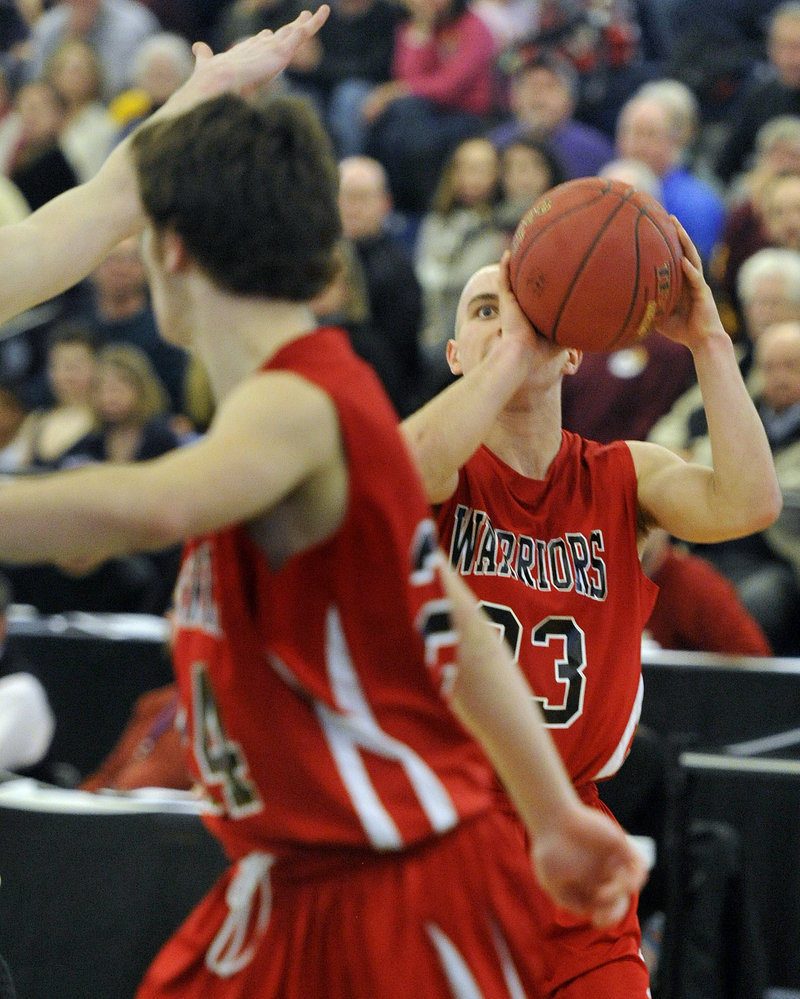 Chris Carney of Wells keeps his focus on the basket before unleashing a 3-pointer against Cape Elizabeth.