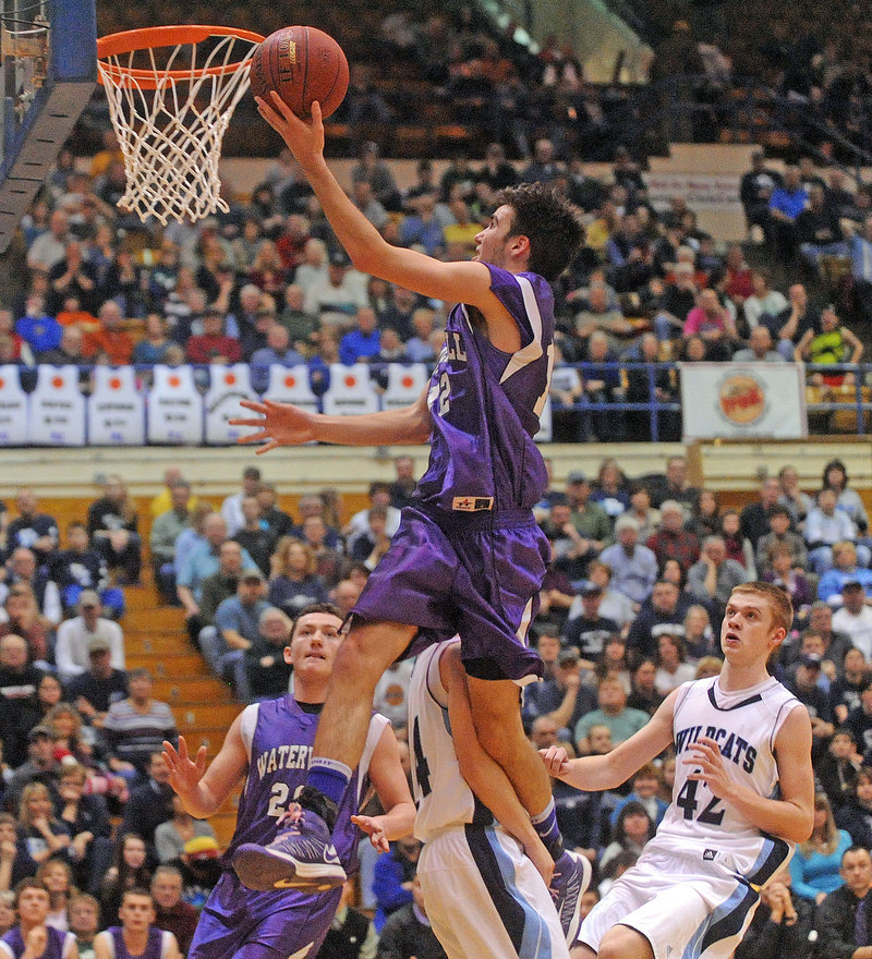 Justin Jabar of Waterville soars to the basket during an Eastern Class B quarterfinal Saturday against Presque Isle, which defeated the Purple Panthers, 47-45.