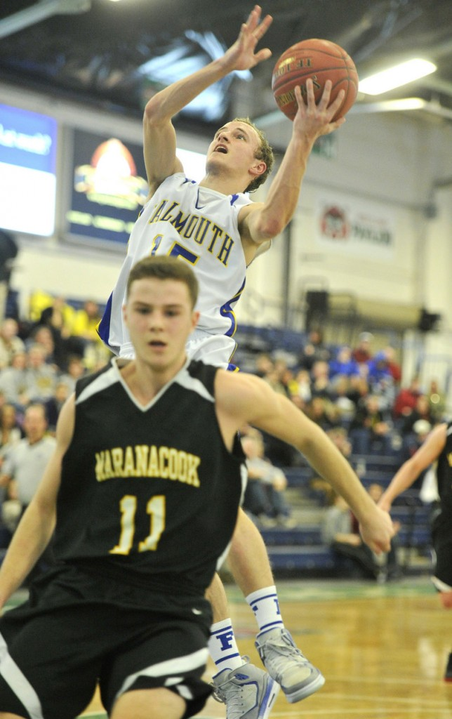 Falmouth's Grant Burfeind goes strong to the basket against Taylor Wilbur during the top-ranked Yachtsmen's 58-30 win over Maranacook at the Portland Expo.