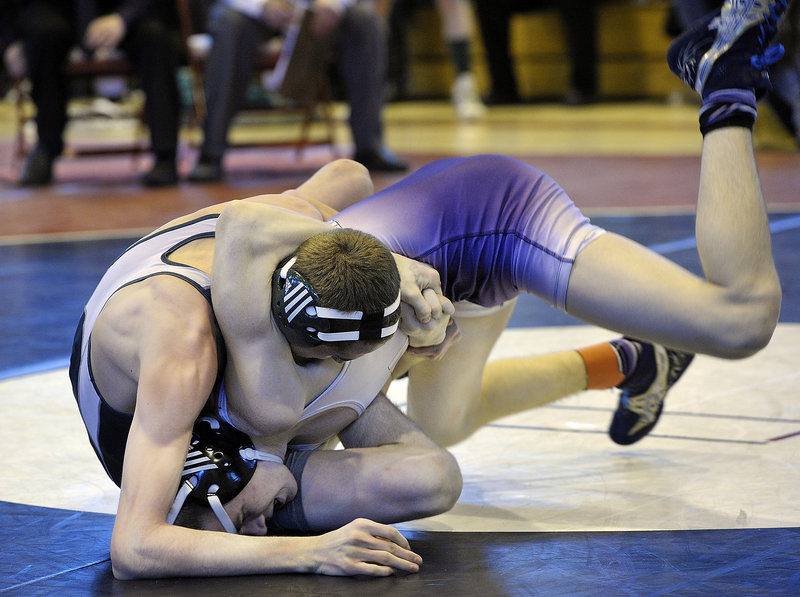 Tyler Davidson, right, of Marshwood rolls out of a hold by John Gillar of Bonny Eagle into a winning position in the semifinals of the 120-pound weight class at the Class A state wrestling meet Saturday in Sanford. Davidson went on to win the fourth state championship of his career, and Marshwood also won the team title.
