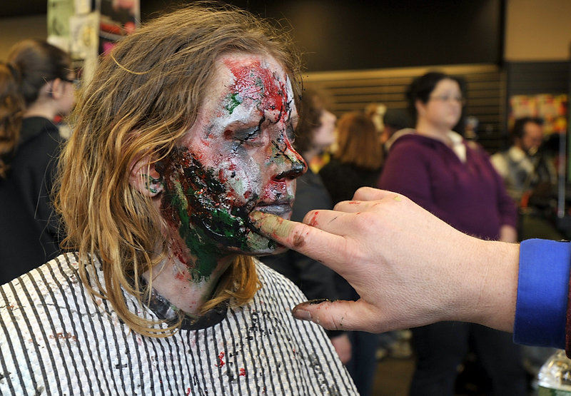 Wengland gets the gruesome treatment during Saturday's Zombie Blast at Bull Moose in Scarborough.