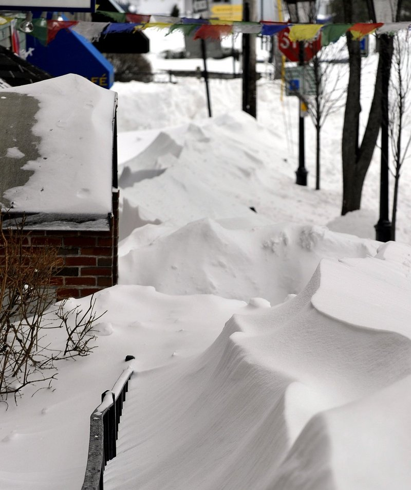 Drifts cover the sidewalk along Moulton Street in Portland on Feb. 9, making it impassable following the Blizzard of 2013. After the storm, city firefighters took to the streets to dig out nearly 2,000 fire hydrants, a reader says.