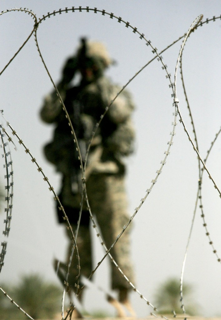 A U.S. soldier eyes the road while on patrol near Youssifiyah, Iraq, in 2007. Lack of education is one reason 75 percent of young Americans are ineligible for military service, but high-quality early learning programs can help reverse that trend, a reader says.