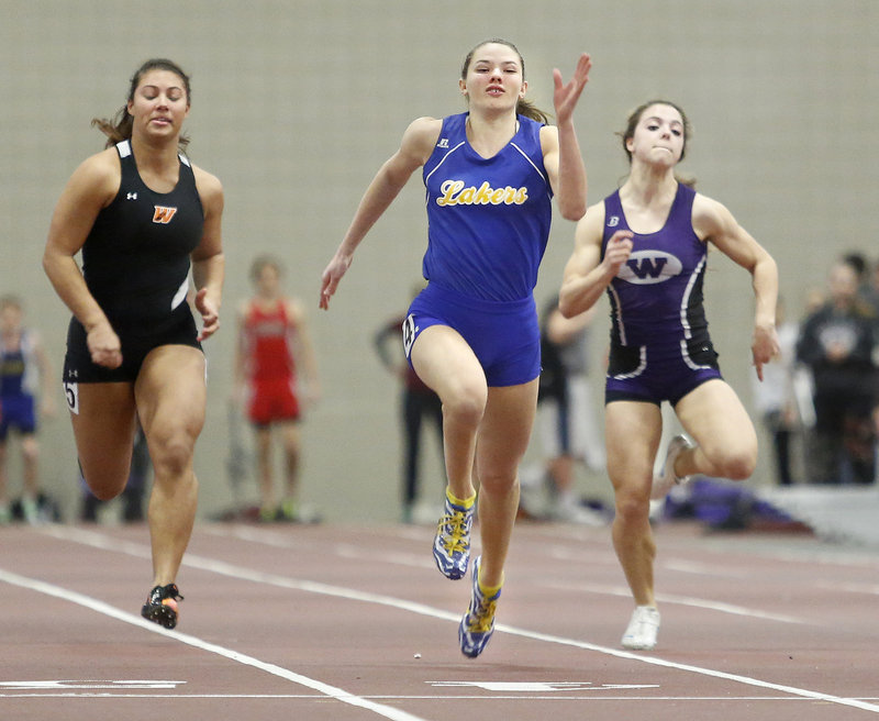 Kate Hall of Lake Region stays ahead of Georgia Bolduc of Waterville to win the 55-meter dash at the Class B state meet Monday at Bates College in Lewiston. Hall also won the 200 and long jump, setting Class B records in both events.