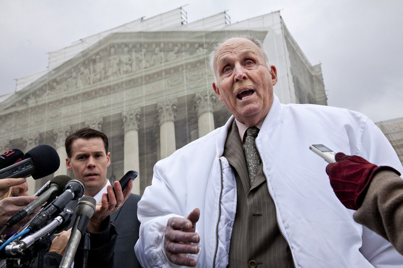 Vernon Hugh Bowman, 75, an Indiana soybean farmer, speaks with reporters outside the Supreme Court on Tuesday.