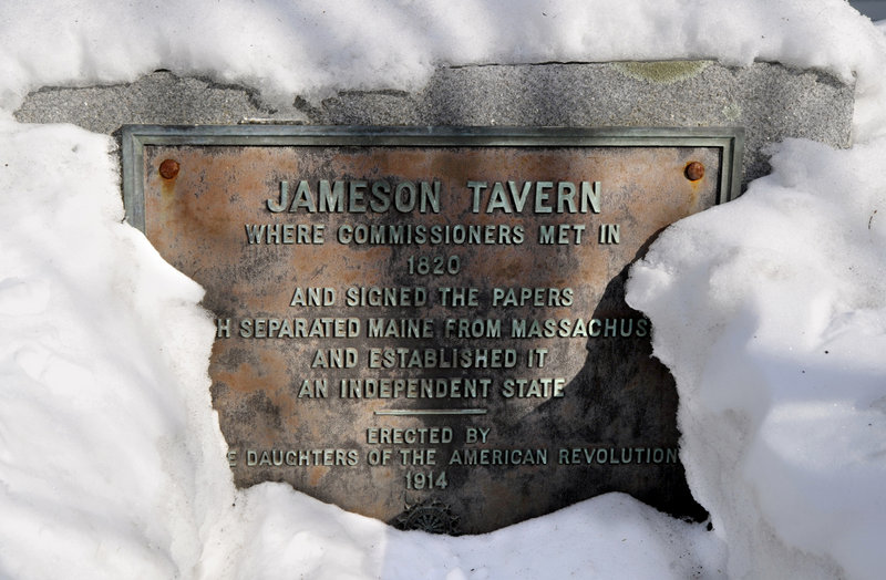 A plaque on the exterior of Jameson Tavern in Freeport claims