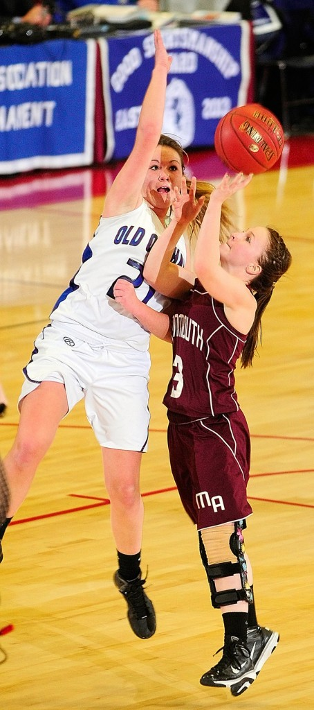Ashley Coulombe, right, of Monmouth Academy attempts to get a shot past Abby Dubois of Old Orchard Beach during OOB's 63-57 victory in Augusta.
