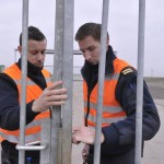 Airport security guards secure an entrance to the tarmac at Zaventem international airport near Brussels