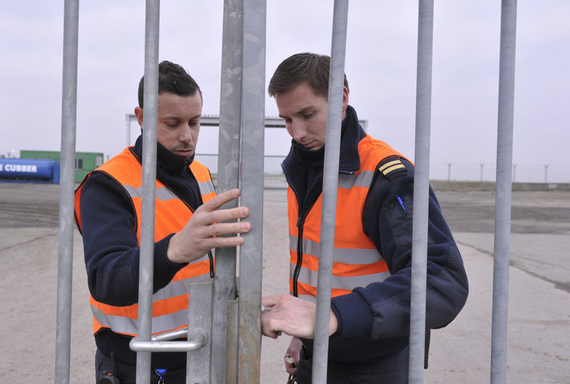 Guards secure an entrance at Zaventem international airport near Brussels on Tuesday following the robbery of $50 million in diamonds a day earlier.