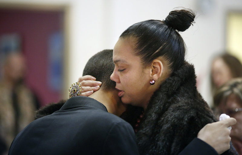 Mikey Epperson, 16, of New London, Conn., at left, is comforted by Sondra Wilson of Virginia, at right, before the start of a memorial service for Epperson's grandmother and Wilson's mother, Dale Fussell, 64, at the United Church of Christ on Congress Avenue in Bath Tuesday, February 19, 2013. Fussell was killed Tuesday, Feb. 12, in a propane explosion at her Bluff Road duplex.