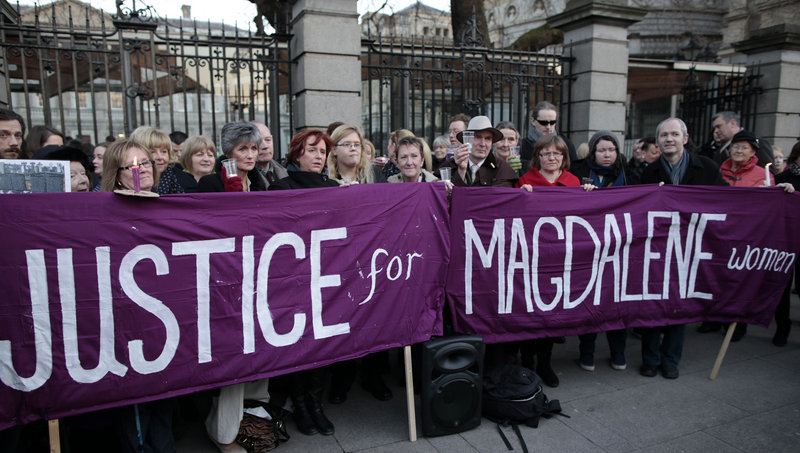 """Relatives of victims of the Magdalene Laundries – where women branded """"fallen"""" were consigned – hold a vigil Tuesday in Dublin."""