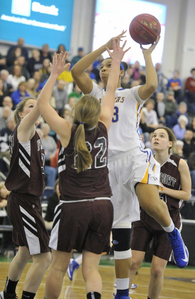 Tiana-Jo Carter of Lake Region prepares to take a shot over Jocelyn Davee of Freeport during the Lakers' 65-29 victory in the Western Class B quarterfinals.