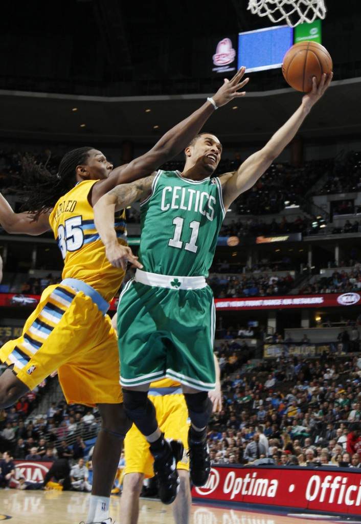 Celtics guard Courtney Lee drives the lane for two points despite tenacious defense from Nuggets forward Kenneth Faried during Tuesday's game in Denver.