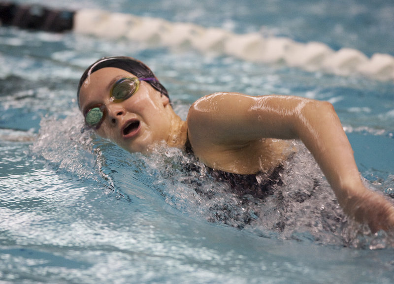 Lynsie Russell of Brunswick heads to the finish while competing in the grueling 500-yard freestyle. Russell, a freshman, won the event in 5 minutes, 25.64 seconds – exactly 13 seconds ahead of the runner-up, Alyssa Reardon of Bangor.