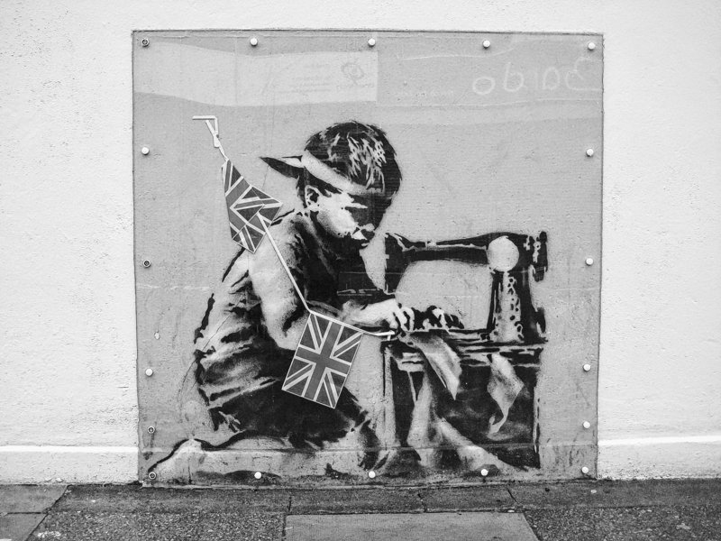 This stencil by the British graffiti artist Banksy, which vanished from the side of a London store, is expected to bring $500,000-$700,000 at an auction Saturday.