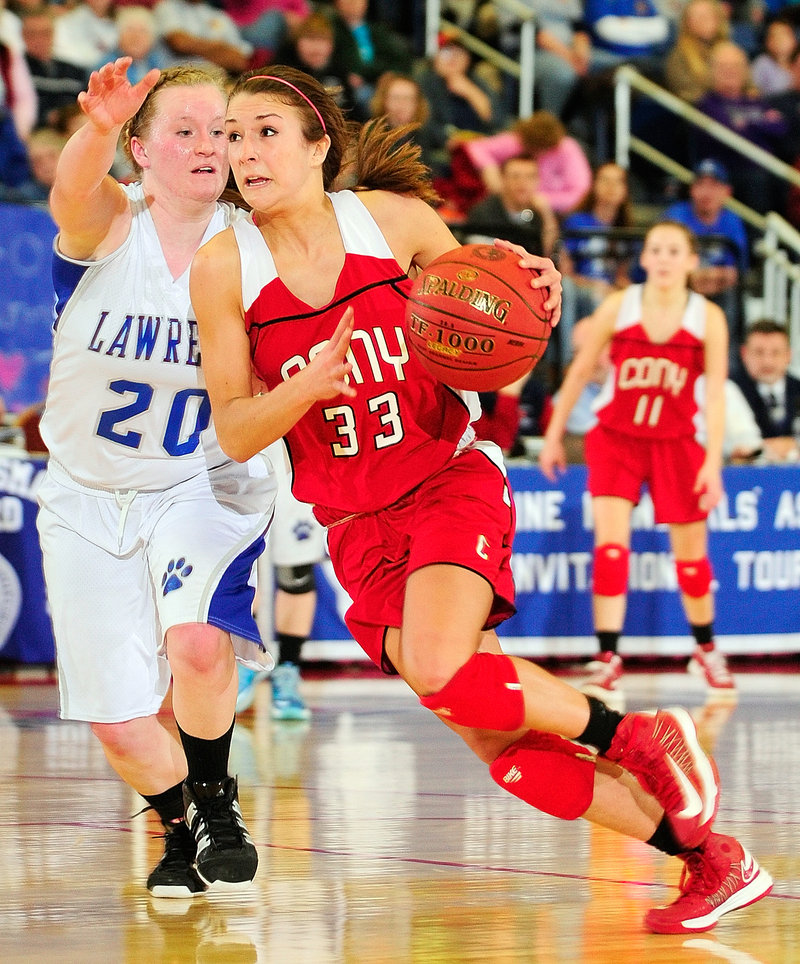 Josie Lee of Cony drives against Jordyn Towers during their Eastern Class A semifinal Wednesday at the Augusta Civic Center. Cony won 49-37.