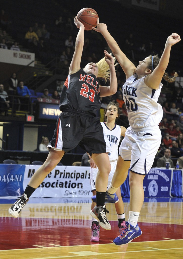 Marquis MacGlashing, right, of York blocks a shot by Alison Furness of Wells. York won 40-38 to advance to the Western Class B final.
