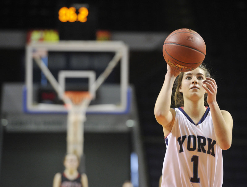 Ruby Cribby of York keeps her focus while hitting two late foul shots Thursday, points that proved decisive as the Wildcats beat Wells 40-38 at the Cumberland County Civic Center to reach the Western Class B final Saturday.