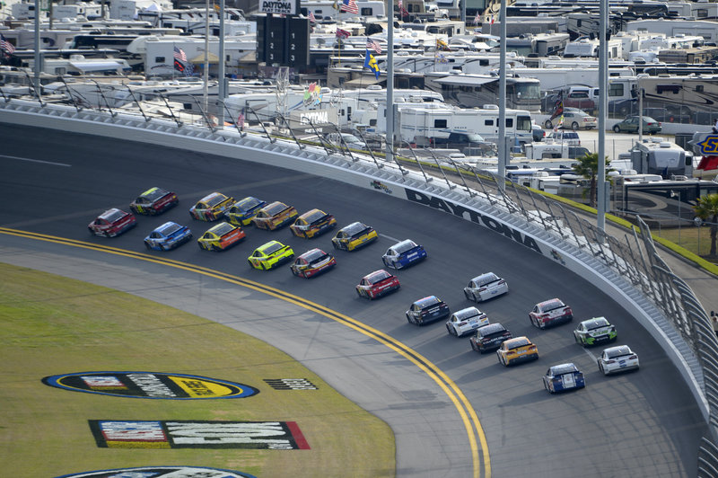 Racers make their way into Turn 1 of the Daytona International Speedway during the second of two 150-mile qualifying races Thursday for the NASCAR Daytona 500.