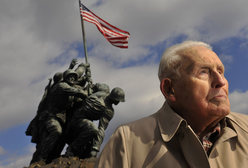 Norm Hatch, 91, poses for a portrait near the U.S. Marine Corps War Memorial, which is also referred to as the Iwo Jima Memorial, on Wednesday in Arlington, Va.
