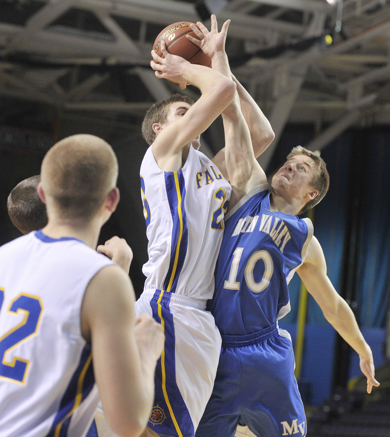 Charlie Fay of Falmouth is fouled by Adam Volkernick of Mountain Valley while going up for a shot. Fay scored 12 points for the Yachtsmen.