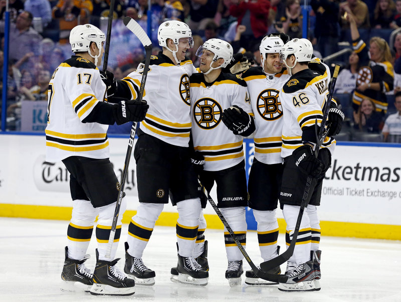 The Bruins, from left, Milan Lucic, Dougie Hamilton, Dennis Seidenberg, Nathan Horton and David Krejci celebrate a first-period goal during Thursday's win at Tampa.