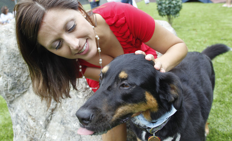 Jenny Wilson hugs Honey Belle last summer in Alabaster, Ala. The American Pet Products Association's President and CEO Bob Vetere predicts another 4 percent gain this year.