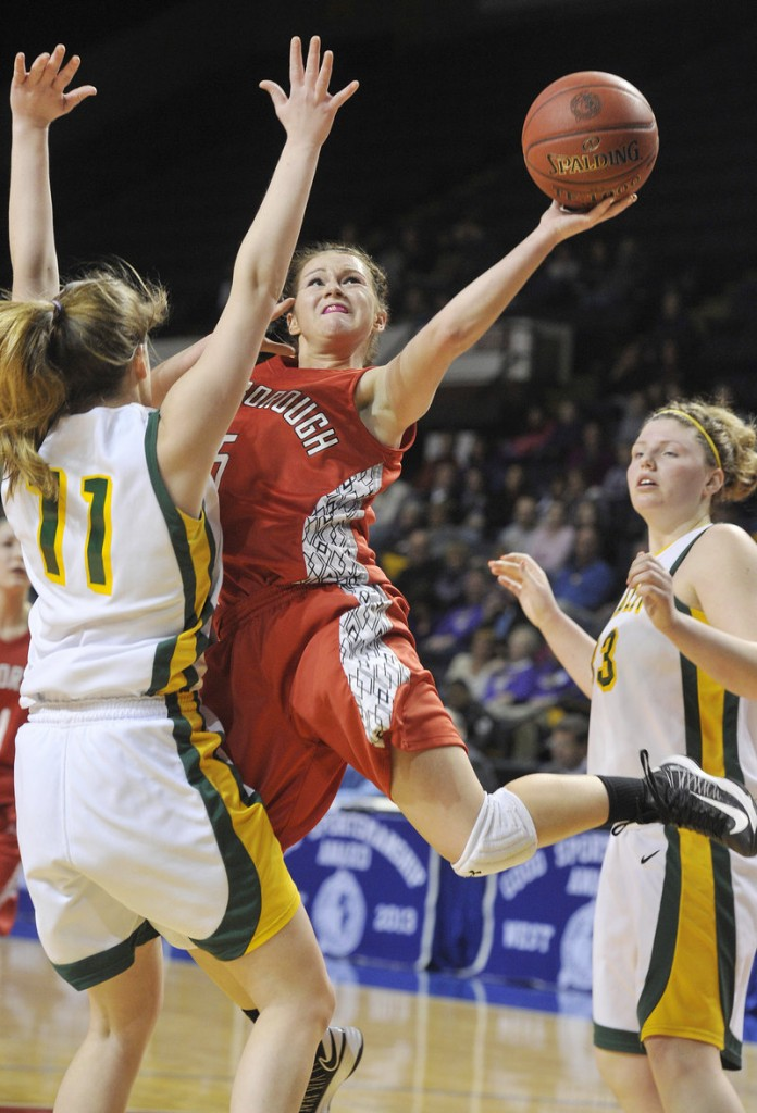 Mary Redmond of Scarborough tries to get a shot over Molly Mack of McAuley during McAuley's 47-38 victory in a Western Class A girls' basketball semifinal Friday night at the Cumberland County Civic Center.